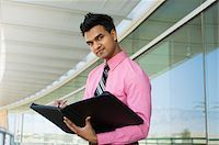 planner - Businessman Writing in a Planner Stock Photo - Premium Royalty-Freenull, Code: 694-03329872