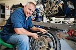 Mechanic Working on a Tire Stock Photo - Premium Royalty-Free, Artist: Cusp and Flirt, Code: 694-03330274