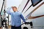 Man Refueling RV Stock Photo - Premium Royalty-Freenull, Code: 694-03330309