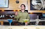 Bartender Tossing Shaker in the Air Stock Photo - Premium Royalty-Freenull, Code: 694-03331318