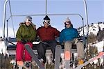 Three Skiers on Chair Lift Stock Photo - Premium Royalty-Freenull, Code: 694-03331333
