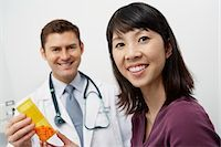 Doctor giving female patient medication in hospital Stock Photo - Premium Royalty-Freenull, Code: 694-03331710