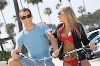 Couple on bikes at the beach Stock Photo - Premium Royalty-Freenull, Code: 694-03332321