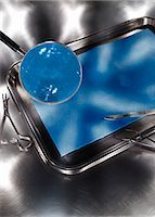 Magnifying Glass Over Dissection Tray Stock Photo - Premium Royalty-Freenull, Code: 600-03333174