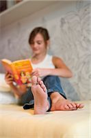 Teenage Girl Reading Book on Bed Stock Photo - Premium Rights-Managednull, Code: 700-03333119