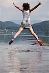 Woman Jumping in Shallow Water, Fuschlsee, Salzburg, Austria Stock Photo - Premium Rights-Managed, Artist: Bettina Salomon, Code: 700-03333143