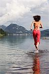 Woman Running Through Shallow Water, Fuschlsee, Salzburg, Austria Stock Photo - Premium Rights-Managed, Artist: Bettina Salomon, Code: 700-03333144