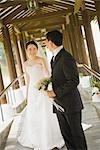 Newlywed Couple on Covered Bridge Stock Photo - Premium Royalty-Free, Artist: Marcus Mok, Code: 600-03333304