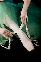 The hands of ballet dancer tying a pointe shoe Stock Photo - Premium Royalty-Freenull, Code: 653-03334251