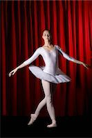 A ballet dancer posing on stage Stock Photo - Premium Royalty-Freenull, Code: 653-03334260