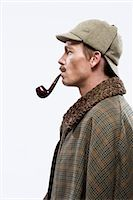 A man dressed up as Sherlock Holmes Stock Photo - Premium Royalty-Freenull, Code: 653-03334454