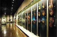 exhibition - China,Shanghai,Shanghai Museum. Chinese Minority Nationalities Art Gallery - colour lacquered wooden masks for Di Xi. Stock Photo - Premium Rights-Managednull, Code: 862-03351250