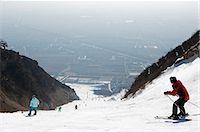 panoramic winter scene - China,Beijing,Shijinglong ski resort. Skiers on the mountain. Stock Photo - Premium Rights-Managednull, Code: 862-03351465