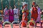 China,Beijing. Chinese New Year Spring Festival - Marriage ceremony celebrations at Daguanyuan Grand View Garden. The performance is taken from the life of an imperial family described in the well-known Chinese novel A Dream of Red Mansions by a Qing Dynasty writer Cao Xueqin. Stock Photo - Premium Rights-Managed, Artist: AWL Images, Code: 862-03351544
