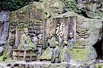 China,Sichuan Province,Mt Emei Unesco World Heritage site. Stone sculpture rock carvings of an ancient priest Stock Photo - Premium Rights-Managed, Artist: AWL Images, Code: 862-03351687
