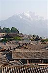 China,Yunnan province,Lijiang old town rooftops and Jade Peak Snow Mountain (Yulong Xueshan),Unesco World Heritage Site Stock Photo - Premium Rights-Managed, Artist: AWL Images, Code: 862-03351730
