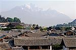 China,Yunnan province,Lijiang old town rooftops and Jade Peak Snow Mountain (Yulong Xueshan),Unesco World Heritage Site Stock Photo - Premium Rights-Managed, Artist: AWL Images, Code: 862-03351731