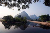 China,Guangxi Province,Yangshuo near Guilin. Karst limestone mountain scenery on the Li River Stock Photo - Premium Rights-Managednull, Code: 862-03351779