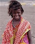 A pretty tousle-haired girl of the nomadic Afar tribe wears bright colours in stark contrast to the drab,windswept surroundings of Lake Abbe. Stock Photo - Premium Rights-Managed, Artist: AWL Images, Code: 862-03352642