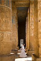 egyptian hieroglyphics - The colours of the original painting dating from the New Kingdom can still be seen on the columns of Ramses III's mortuary temple at Medinet Habu on the West Bank,Luxor,Egypt Stock Photo - Premium Rights-Managednull, Code: 862-03352909