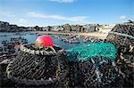 Lobster pots on the quayside at St Ives,Cornwall. Once the home of one of the largest fishing fleets in Britain,the industry has since gone into decline. Tourism is now the primary industry of this popular seaside resort town. Stock Photo - Premium Rights-Managed, Artist: AWL Images, Code: 862-03353055