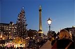 Passers by enjoy Christmas carols in Trafalgar Square Stock Photo - Premium Rights-Managed, Artist: AWL Images, Code: 862-03353274