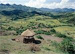 Scenery between Desse and Bati in the Welo Province of northern Ethiopia with an unfinished thatched house in the foreground. Upturned clay pots are often placed over the protruding centre poles of houses to prevent rain getting in. . Stock Photo - Premium Rights-Managed, Artist: AWL Images, Code: 862-03353963