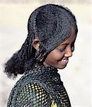 The fetching hairstyle of a young Afar girl. Proud and fiercely independent,the nomadic Afar people live in the low-lying deserts of Eastern Ethiopia. Stock Photo - Premium Rights-Managed, Artist: AWL Images, Code: 862-03353970
