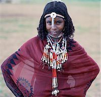 An Afar girl with braided hair has very noticeable scarification on her cheeks. Scarification is practiced in only a few sections of her tribe. Proud and fiercely independent,the nomadic Afar people live in the low-lying deserts of Eastern Ethiopia. Stock Photo - Premium Rights-Managednull, Code: 862-03353975