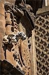 Spain,Andalucia,Seville. A gargoyle forms part of a coat of arms on the wall of Seville Cathedral. Stock Photo - Premium Rights-Managed, Artist: AWL Images, Code: 862-03354527