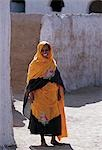 Nubian women wear bright dresses and headscarves even though they are Muslims.