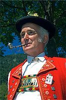A Swiss man smoking a pipe in traditional alpine costume at the Unspunnen Bicentenary Festival,Interlaken,Jungfrau Region,Switzerland Stock Photo - Premium Rights-Managednull, Code: 862-03354681