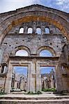 The ruins of the Basilica of St Simeon Stylites the Elder in the hills near Aleppo. St Simeon stood on top of a pillar for 30 years until his death in 459AD. The Basilica was built around the pillar,the remains of which can still be seen. Stock Photo - Premium Rights-Managed, Artist: AWL Images, Code: 862-03354831