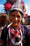 Woman from hilltribe smoking Opium in the Golden Triangle,Thailand Stock Photo - Premium Rights-Managed, Artist: AWL Images, Code: 862-03354985