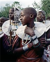 Maasai girls gather to celebrate a wedding. Their broad beaded necklaces with predominantly white glass beads mark then as Kisongo Maasai,the largest clan group of the tribe which lives either side of the Kenya-Tanzania border. Stock Photo - Premium Rights-Managednull, Code: 862-03355142