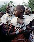 Maasai girls gather to celebrate a wedding. Their broad beaded necklaces with predominantly white glass beads mark then as Kisongo Maasai,the largest clan group of the tribe which lives either side of the Kenya-Tanzania border. Stock Photo - Premium Rights-Managed, Artist: AWL Images, Code: 862-03355142
