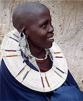 A Maasai woman wearing a very fine beaded necklace. The predominant white colour of her glass beadwork marks her as a Kisingo Maasai,the largest clan group of her tribe living either side of the Kenya-Tanzania border. Stock Photo - Premium Rights-Managednull, Code: 862-03355143