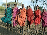 Young Datoga men jump high in the air during a dance. The Datoga (known to their Maasai neighbours as the Mang'ati and to the Iraqw as Babaraig) live in northern Tanzania and are primarily pastoralists. Stock