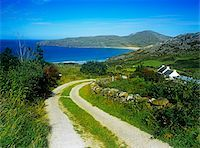 Dirt road passing through a landscape, Rosguill Peninsula, Tranarossan Bay, County Donegal, Republic Of Ireland Stock Photo - Premium Rights-Managednull, Code: 832-03358675