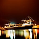 Container Ship;  Ship illuminated at night Stock Photo - Premium Rights-Managed, Artist: IIC, Code: 832-03359015