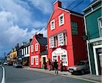 Dingle, Co Kerry, Ireland;  Colorful buildings in a town including a Bed and Breakfast with a pub
