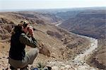 Oman,Dhofar. Scientist Tessa McGregor checks the surronding habitat during an Arabian leopard survey. Stock Photo - Premium Rights-Managed, Artist: AWL Images, Code: 862-03360345