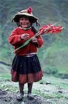A Runa girl proudly shows off a gladioli. With the drab colours of the landscape as a background,the natives love of bright colours and particularly flowers is especially clear. Stock Photo - Premium Rights-Managed, Artist: AWL Images, Code: 862-03360731