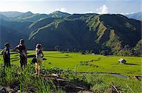 philippine terrace farming - Philippines,Luzon Island,The Cordillera Mountains,Kalinga Province,Tinglayan. Western tourists and guide looking at rice terraces in Luplula village. Stock Photo - Premium Rights-Managednull, Code: 862-03360801