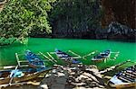 Philippines,Palawan,Sabang Town. Subterranean River National Park - paddle boats at entrance to Riverine Cave - longest navigable river traversed tunnel in the world. Stock Photo - Premium Rights-Managed, Artist: AWL Images, Code: 862-03360815