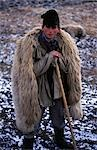 Local shepherd with traditional sheep skin coat and dog Stock Photo - Premium Rights-Managed, Artist: AWL Images, Code: 862-03360981