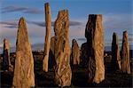 Sunset over the central circle of standing stones at Callanish. An ancient stone circle dating back to Neolithic times,Callanish is the most dramatic prehistoric site in the Hebrides and is sometimes referred to as the Stonehenge of Scotland Stock Photo - Premium Rights-Managed, Artist: AWL Images, Code: 862-03361359