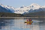 Kayakers paddle the calm waters of Alaska's Inside Passage with Herbert Glacier in the background, Tongass National Forest near Eagle Beach State Recreation Area. Stock Photo - Premium Rights-Managed, Artist: AlaskaStock, Code: 854-03361806