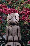 Totem pole surrounded by flowers Juneau Southeast AK summer Stock Photo - Premium Rights-Managed, Artist: AlaskaStock, Code: 854-03362300