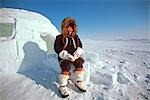 Alaskan Eskimo Woman sitting outside igloo Nome AK Western Winter Scenic White Snow Stock Photo - Premium Rights-Managed, Artist: AlaskaStock, Code: 854-03362331